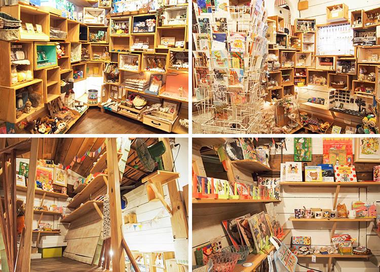 一進門就能看到許多擺放著商品的大小格子 下排為店內搭造的小閣樓,閣樓裡是日本畫家團體marini*monteany(マリーニ*モンティーニ)的商品專區