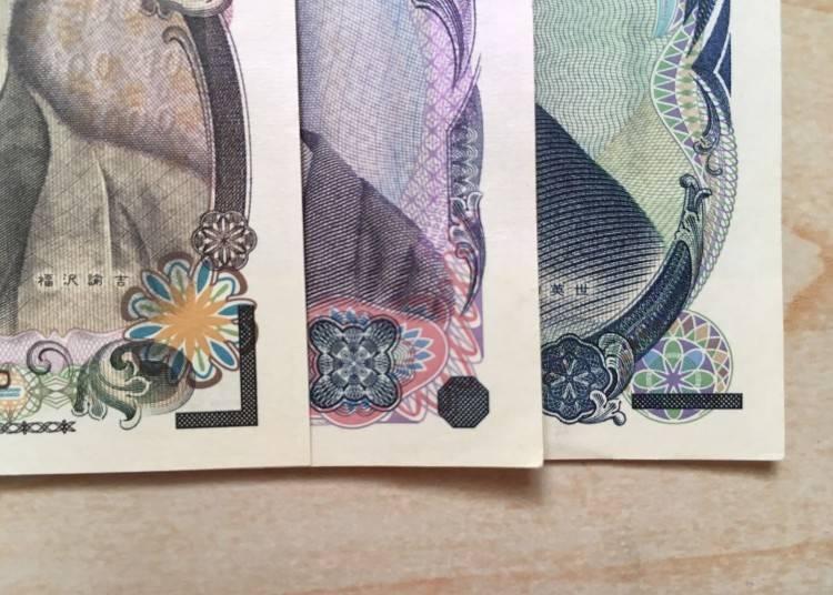 照片由左而右,鑰匙形(1萬日幣)、八角型(5千日幣)、橫條型(1千日幣)。