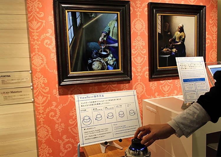 藉由操作遙控桿得以用不同角度觀賞名畫「ViewPaint 梅維爾《倒牛奶的女僕》」製作・著作:凸版印刷株式會社 / 監修:小林賴子(目白大學教授) / Original photo data (Het melkmeisje [The Milkmaid] by Johannes Vermeer):©Rijksmuseum Amsterdam. Purchased with the support of the Vereniging Rembrandt.