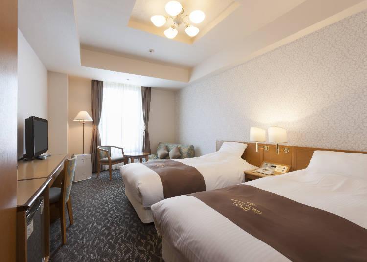 簡單的房型設計,讓人有一種身心放鬆的精緻雙床房。