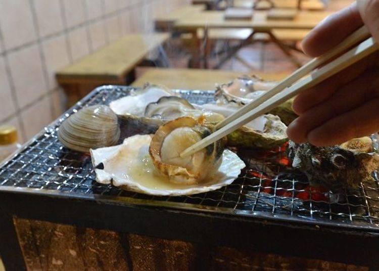▲烤得熱呼呼的干貝,生吃也完全沒問題的鮮度,烤過之後風味加倍!