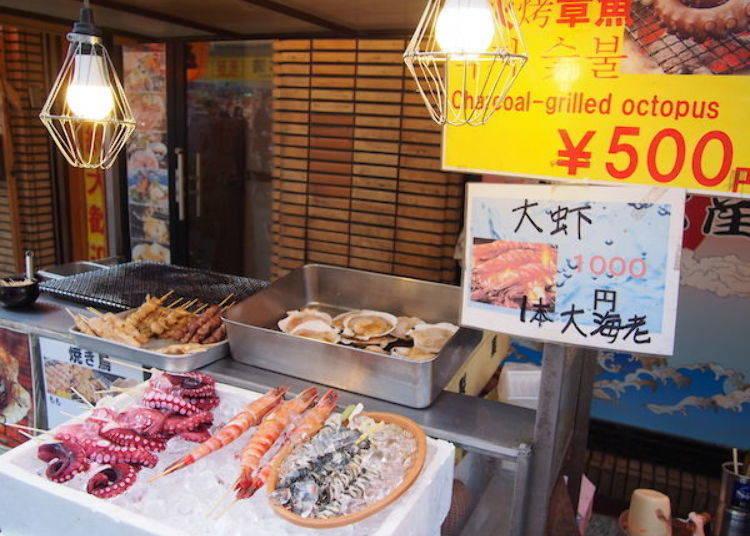 ▲這個攤位是為了迎合中國人觀光客,可看出道頓堀的人氣眾所皆知。